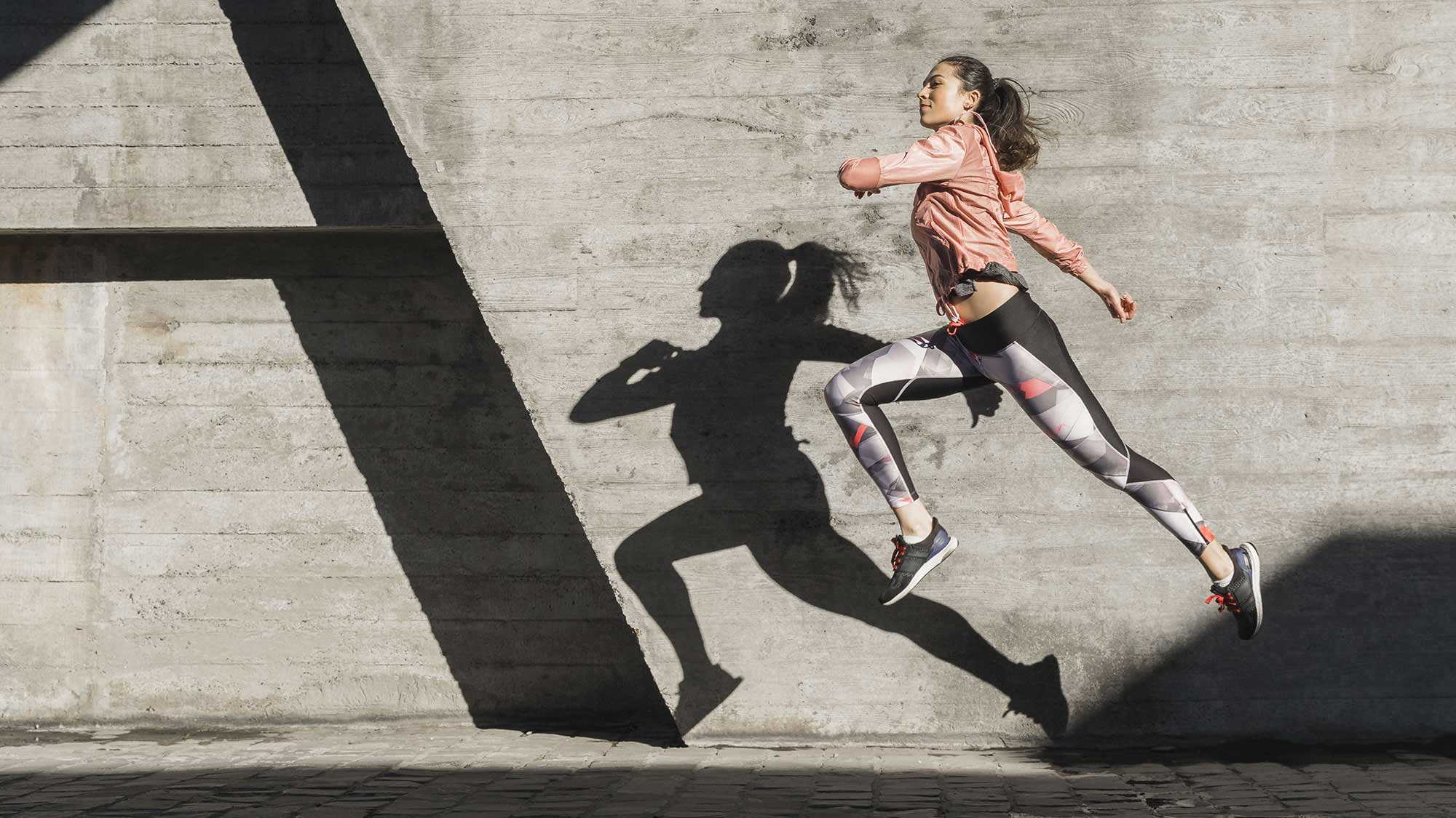 Happy Woman running and exercising w/o hinderance